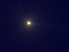 Ein gelb strahlender Stern vor dunkelblauem Hintergrund